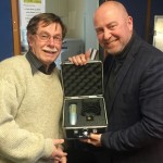 Peter Miller hands over new microphone to Darren